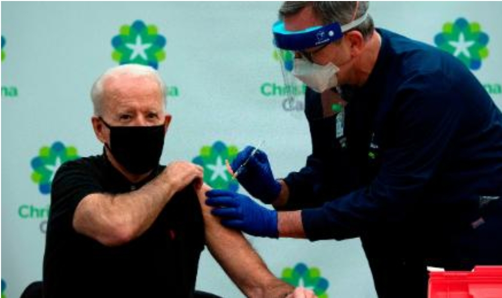 ไบเดน เรียกร้องให้สวมหน้ากากหลังจากได้รับวัคซีนเข็มที่สอง